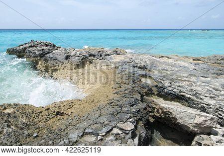 The Wave Hitting Rocky Eroded Shore On Half Moon Cay Island (bahamas).