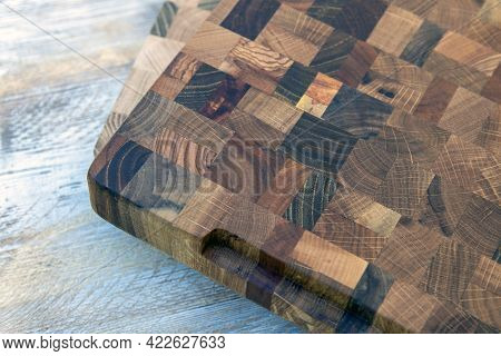 Background Of A Kitchen Cutting Board Made Of Various Hardwoods.