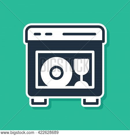 Blue Kitchen Dishwasher Machine Icon Isolated On Green Background. Vector