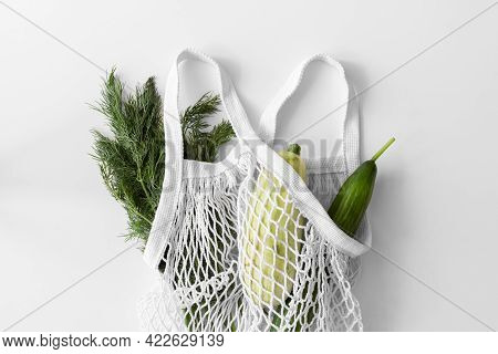 White Mesh Bag, Vegetables Flat Lay On White Background Top View. Eco Friendly, Reusable Shopping Ba