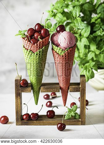 Berry Ice Cream In A Waffle Cone On A Light Background. Cherry Ice Cream. Ice Cream Cone With Cherry