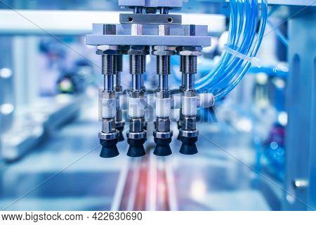 robotic pneumatic piston sucker unit on industrial machine,automation compressed air factory production