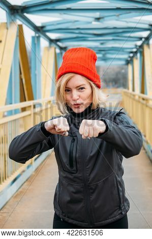 Fit Sporty Middle Aged Blonde 40s Woman In Red Cap Doing Jogging Workout, Stretching, Enjoying Fitne