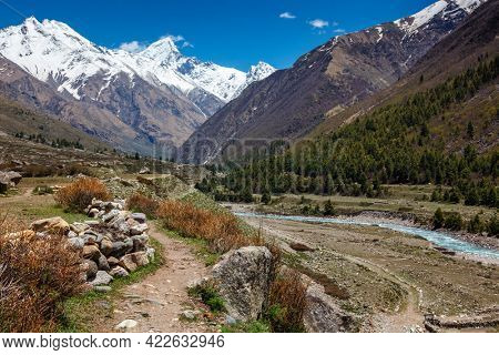 Old trade route in Himalaya surrounded with stones to Tibet from Chitkul village from Sangla Valley. Himachal Pradesh, India
