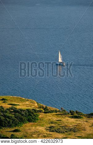 Yacht boat in Aegean sea near Milos island on sunset. Milos island, Greece