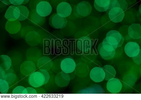 Textured Background Green Bokeh From Out Of Focus Christmas Lights On Tree Taken From Up Close Creat