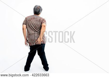 The Back Of A Man Which Uses Left Hand Hold Ass Area And Hold A Tissue Whit Right Hand, On White Bac