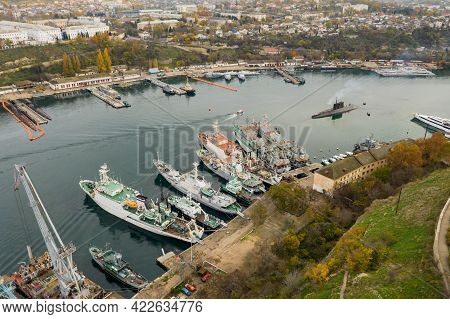 Bay With Ships In The City. South Bay In Sevastopol With Civilian And Military Ships. The Submarine