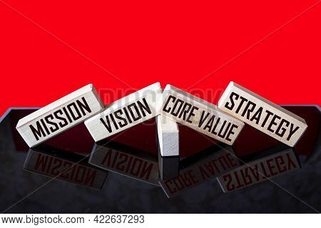 Mission, Vision, Core Value, Strategy A Symbol Of Our Core Values. Conceptual Words On Wooden Blocks