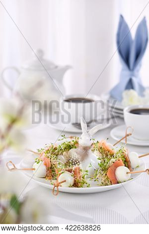 Appetizer Quail Egg Stuffed With Alfalfa Sprouts With A Slice Of Salmon, On A Wooden Skewer. Buffet