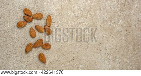 Peeled Almonds. Nut Background, Banner, Almonds In Top View In A Saucer And Scattered Around. Place