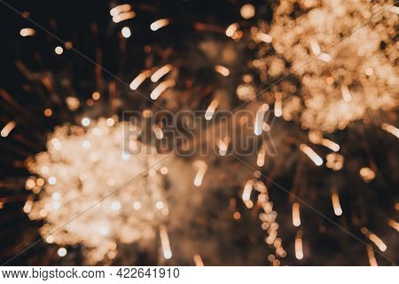 Abstract Photo Of Fireworks. Salute Without Focus. Blurry Photo Of Fireworks. Festive Fireworks. A B