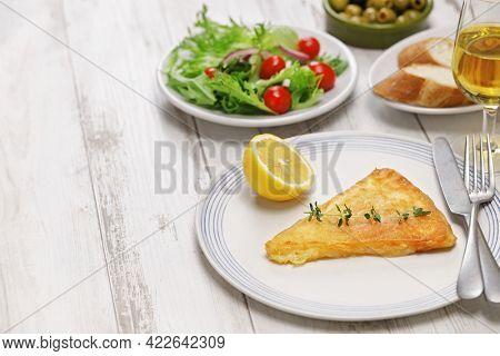 saganaki, Greek fried cheese is one of most popular mezzes in Greek tavernas