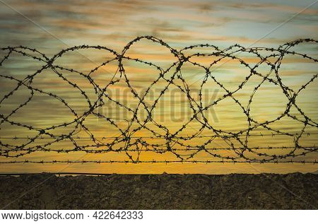Prison. Prison Wall With Barbed Wire. Law And Justice