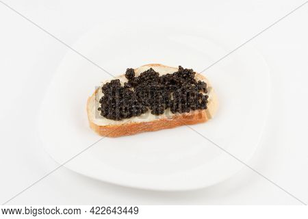 Real, not imitated, beluga caviar on plate, isolated on white