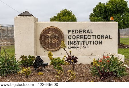 Lompoc, Ca, Usa - May 26, 2021: Closeup Of Beige Name Sign Monument At Entrance To Federal Correctio