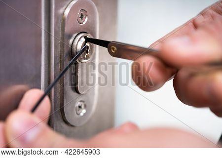 Locksmith Man Fixing Door Lock. Lockpicker Technician
