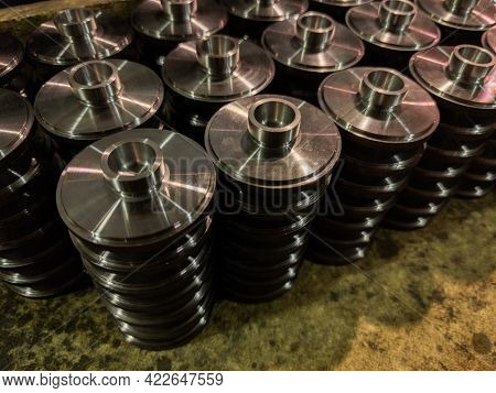 Stacks Of Batch Production Round Parts In A Wooden Box
