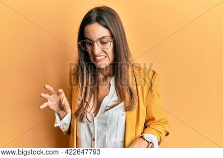 Young beautiful woman wearing business style and glasses disgusted expression, displeased and fearful doing disgust face because aversion reaction.