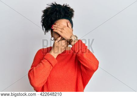 Young african american girl wearing casual clothes covering eyes and mouth with hands, surprised and shocked. hiding emotion