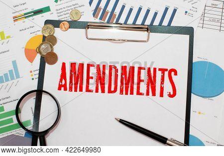 A Blue Folder With The Label Amendments.