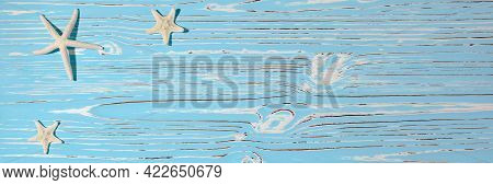 Starfish Seashells On A Wooden Blue Background