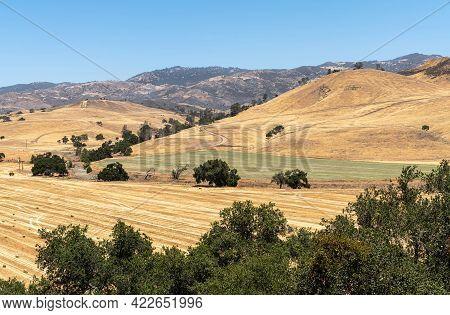 Santa Inez, Ca, Usa - April 3, 2009: San Lorenzo Seminary. Darker Brown Mountains And Yellow Flanks