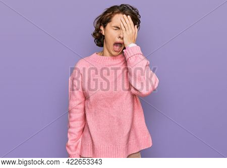 Young hispanic woman wearing casual clothes yawning tired covering half face, eye and mouth with hand. face hurts in pain.