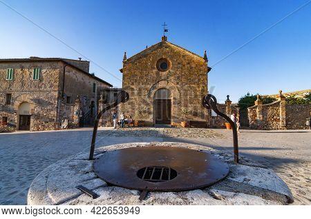 Monteriggioni, Italy - June 15. 2013: The Romanesque Church Of Santa Maria Assunta On Rome Square In