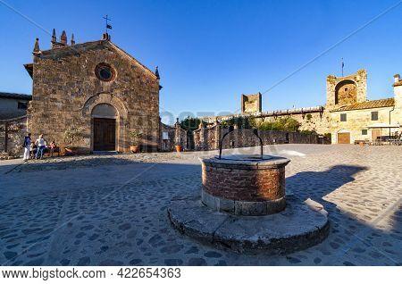 Monteriggioni, Italy - June 15. 2013: The Romansque Church Of Santa Maria Assunta On Rome Square In