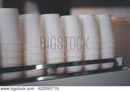 A Lot Of Recycle White Paper Cups Upside Down On Coffee Machine