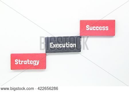 Wooden Cubes And Words For Success Namely Strategy, Success And Execution. Business Concept