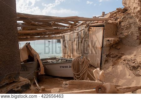 Formentera, Spain : 2021 June 04 : Boat In Formentera Beach Of Calo D Es Mort In Balearic Islands In