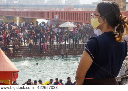 Haridwar, Uttarakhand, India, April 14, 2021. Indian Woman Worship Holy River Ganges Wearing Coronav