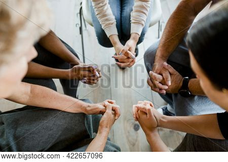 Diverse people in a religious group session