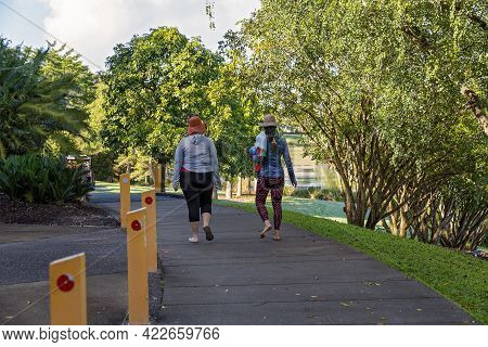 Mackay, Queensland, Australia - June 2021: Two Women Friends Out Walking And Exercising In The Botan
