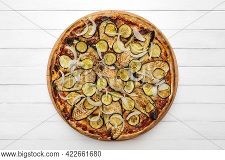 Whole Vegetarian Pizza Topped With Grilled Eggplant, Zucchini And Onion, On Wooden Plate. Top View O