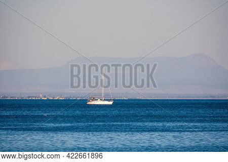 Sailing Yacht In The Blue Calm Sea. A Yacht In Peaceful Waters.