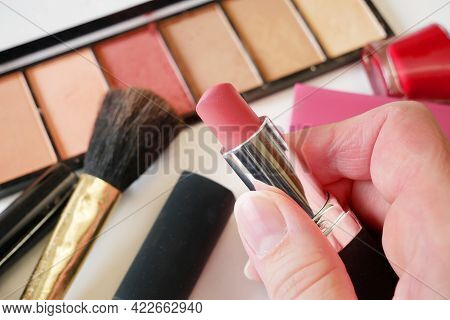 Lipstick And Set Of Cosmetic Makeup Products Background. Lipstick, Eye Shadows, Brush, Powder, Lip G