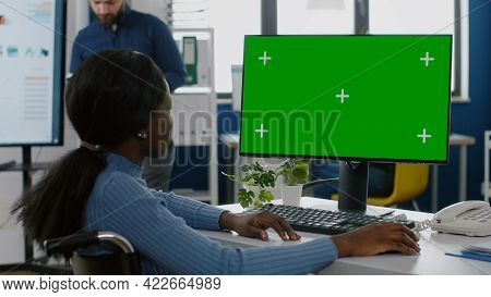 African Disabled Invalid Handicapped Businesswoman Sitting In Wheelchair Analysing Financial Statist
