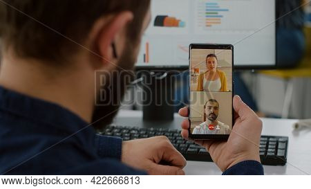 Handicapped Invalid Manager Talking On Videocall With Friends Holding Smartphone Taking Break During