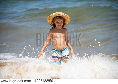 Happy Little Child Running On The Tropical Beach. Boy Playing Sea Waves On Vacation Sea In The Summe