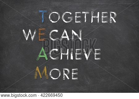 Team Together We Can Achieve More With White Chalk On A Black Background. Teamwork, Synergy Or Busin