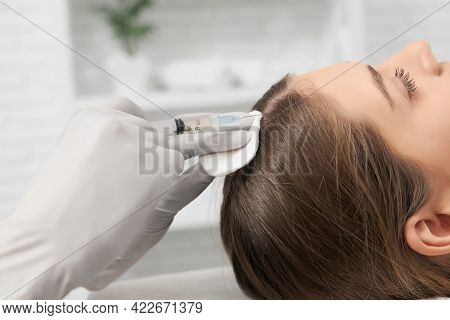 Side View Of Young Brunette Woman On Procedure For Improvements Hair Condition With Special Cosmetic