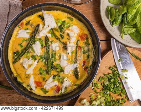 Cooking Process Of Italian Omelet Frittata With Mozzarella Cheese, Spinach And Asparagus - Frying Pa