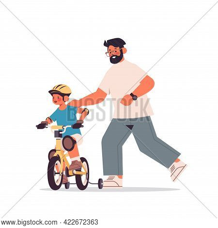 Young Father Teaching Little Son To Ride Bike Parenting Fatherhood Concept Dad Spending Time With Hi