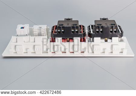 A Block Of Electrical Outlets And A Network Outlet On A Gray Background. Home Electrician. Close-up.