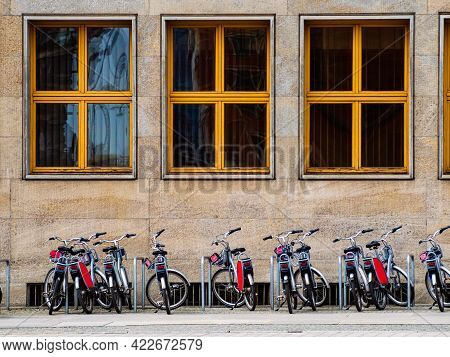 City Bicycles On A Rack, Available For Rent. Rent A Bike In A City. Bike Sharing