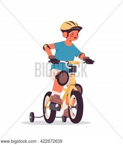 Little Boy In Helmet Riding Bike Childhood Concept