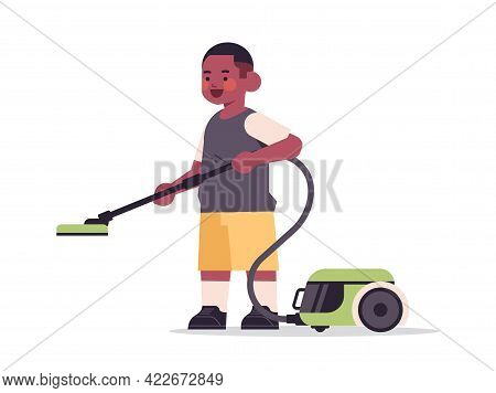 Little African American Boy Using Vacuum Cleaner Cleaning Childhood Concept Full Length Horizontal